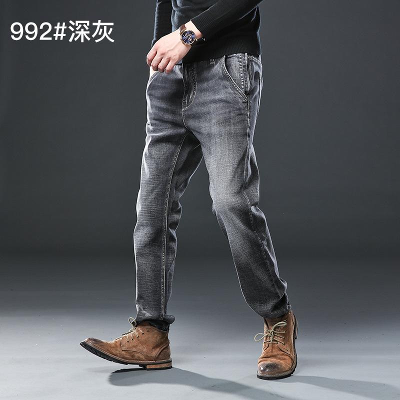 ฤดูใบไม้ร่วงผู้ชายใหม่กางเกงยีนส์ป้องกันการโจรกรรมโดยตรงกางเกงยีนส์ยืดขนาดใหญ่เอวพลัส fatened